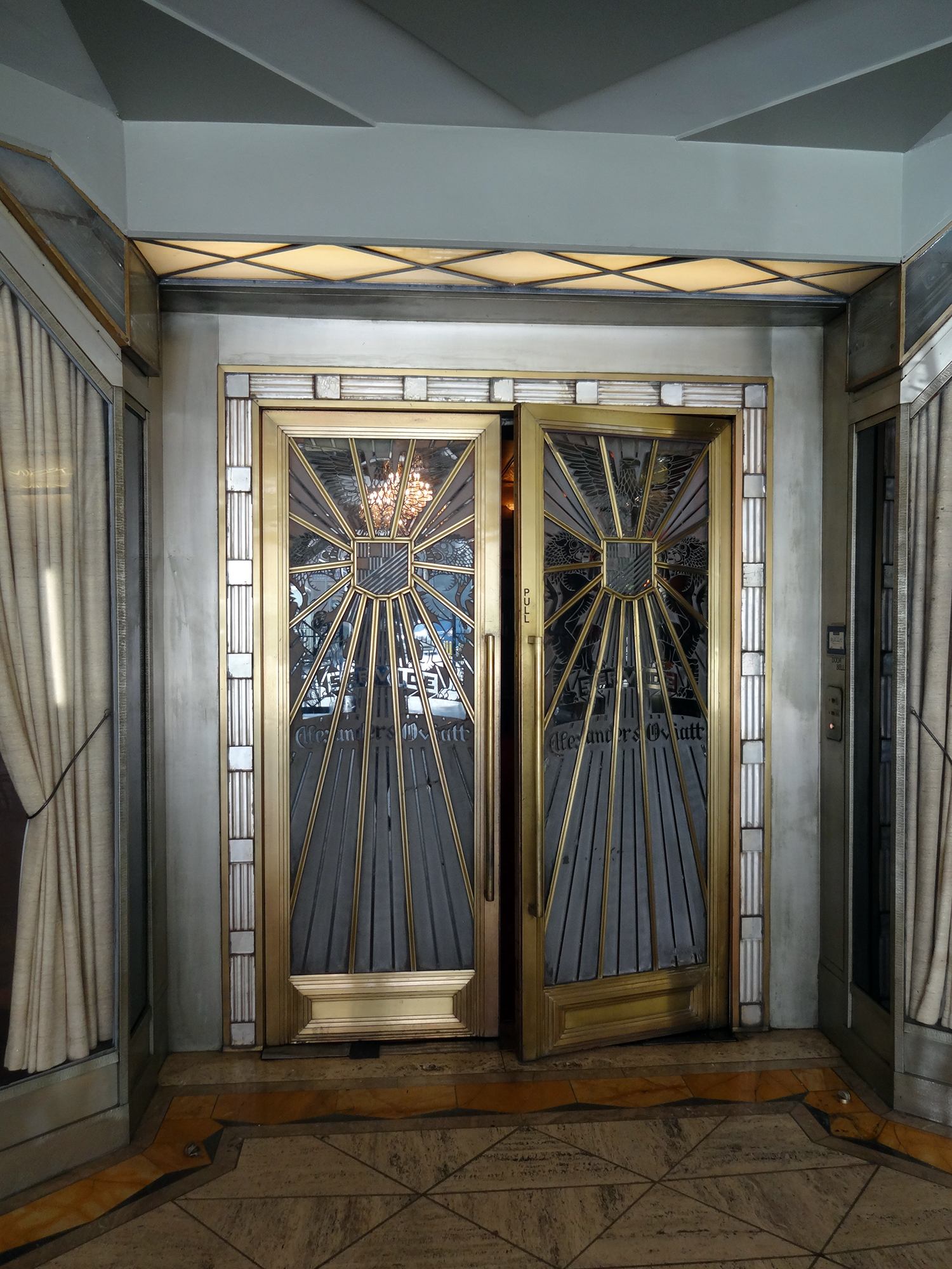 Oviatt building cicada club doors