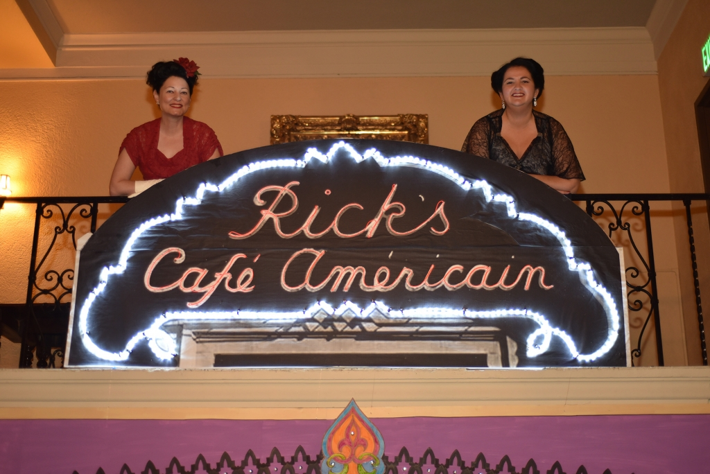 1930s women behind Ricks Cafe Americain sign at the Ebell